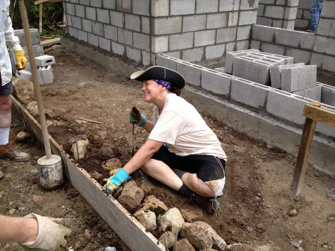 Emily Tenney, of Bloomington, puts dirt in between the rocks that formed the base for a back porch at a Habitat house in San Felipe, El Salvador. She was part of a group of 12 volunteers from Bloomington traveled to El Salvador in early June for a nine-day mission trip to help build a small cinder block house in San Felipe, through the Global Village Program, the international arm of Habitat for Humanity. Habitat in El Salvador is a sister chapter to the one in Monroe County.