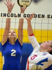 Centerville's Kelsee Troutwine jumps to block against