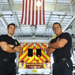 Firefighter/ EMT Charles Cummings and medic Lt. James Dean pose near one of the vehicles used by Brevard County Fire Rescue, which has won an Emergency Medical Services Provider of the Year Award. Photos taken at Station 45 in Rockledge on U.S. 1.