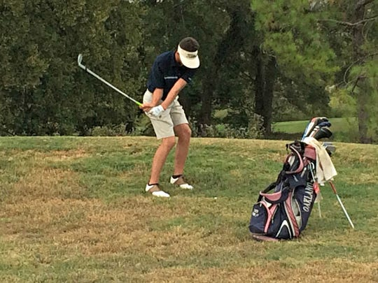 Oakland's Tate Chumley hits out of the rough during a playoff hole at the Region 4-AAA Tournament on Thursday at Indian Hills. Chumley lost the playoff hole, which determined the fourth and final state tourney berth.