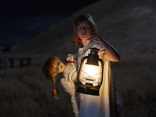 "Linda (Lulu Wilson) carries the Annabelle doll in ""Annabelle:"