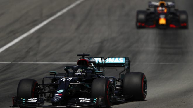 Mercedes driver Lewis Hamilton is chased by Red Bull driver Max Verstappen during the Formula One Grand Prix at the Barcelona Catalunya racetrack in Montmelo, Spain, on Sunday.