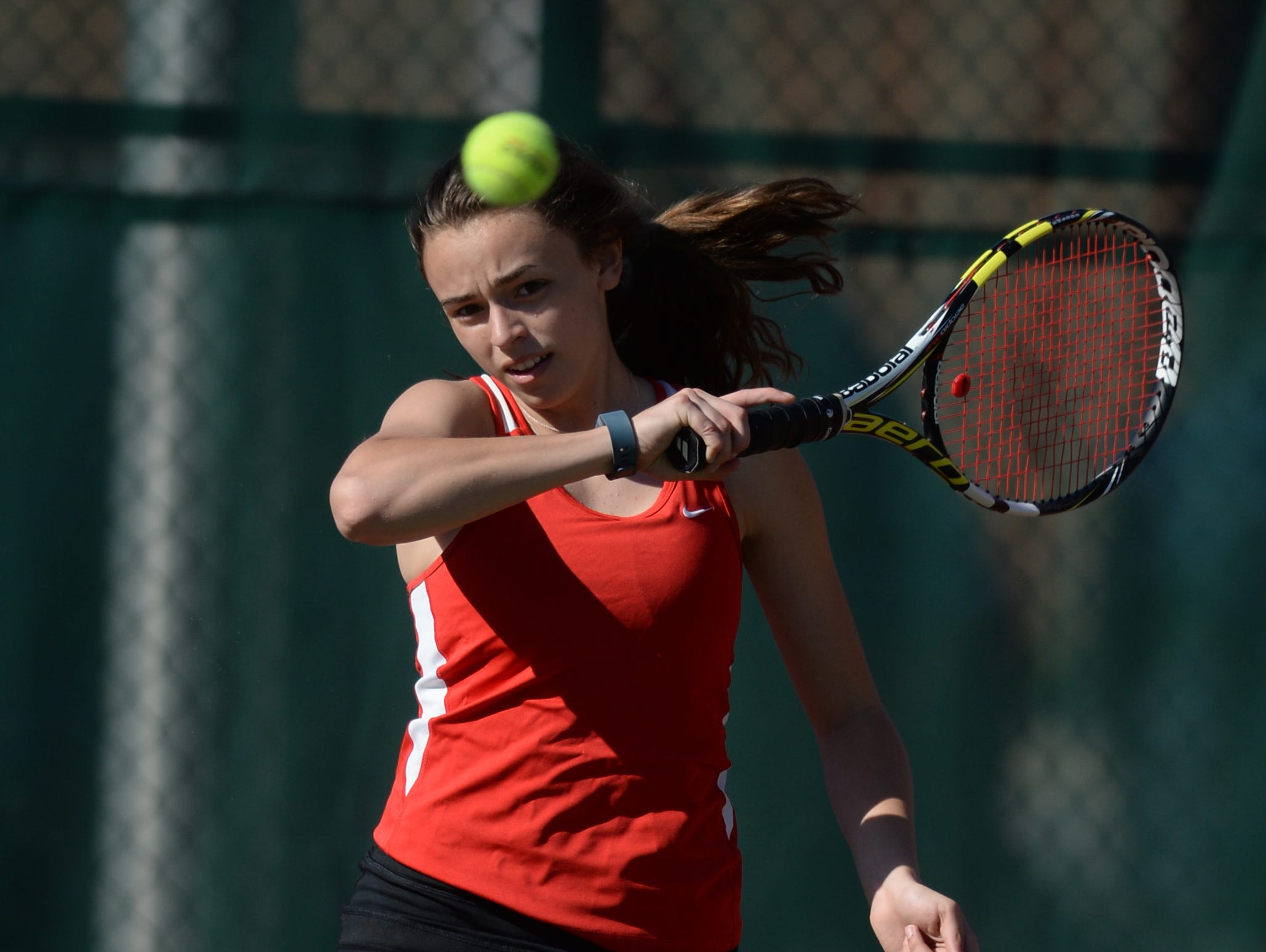 Richmond's Cami Jones returns the ball while playing No. 2 singles this season. The Red Devils drew a bye in the upcoming sectional tournament.