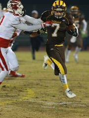 Golden West fullback Gonzalo Rodriguez fights off a