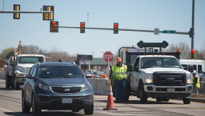 Traffic travels westbound through construction zones on Mulberry Street on Wednesday, April 18, 2018.