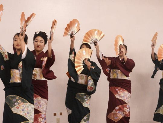Japanese dancers perform at a past Obon Festival in
