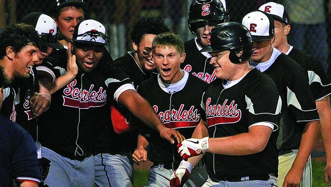 Kyle Thomson, right, is shown after hitting a home run for Des Moines East in 2012. Thomson, 22 and an Iowa State student, died Monday in a weightlifting accident.