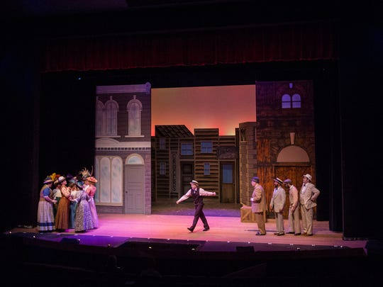 The Music Man cast performs Pick-a-Little during the Music Man dress rehearsal at Sugden Community Theatre on Thursday, March 1, 2018.