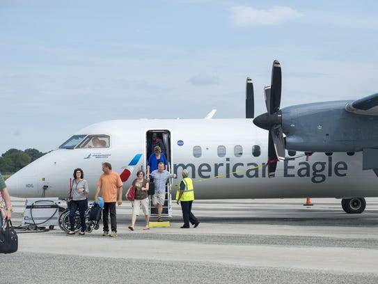 Passengers get off a Piedmont Airlines turboprop, flying