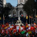 People gather during a protest against the Government  in Madrid, Spain, March 22, 2014.