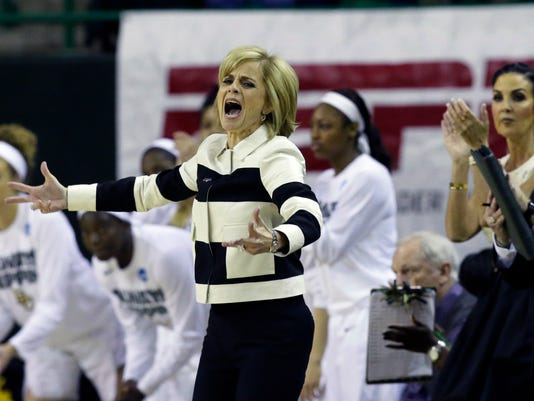 Baylor head coach Kim Mulkey and the bench cheer during the first half of a second-round women's college basketball game against Auburn in the NCAA Tournament Sunday, March 20, 2016, in Waco, Texas. (AP Photo/LM Otero)