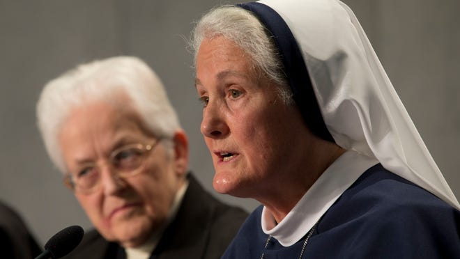 Sister Sharon Holland, left, and Mother Agnes Mary Donovan discuss findings released by the Vatican on Tuesday, at a news conference at the Vatican.