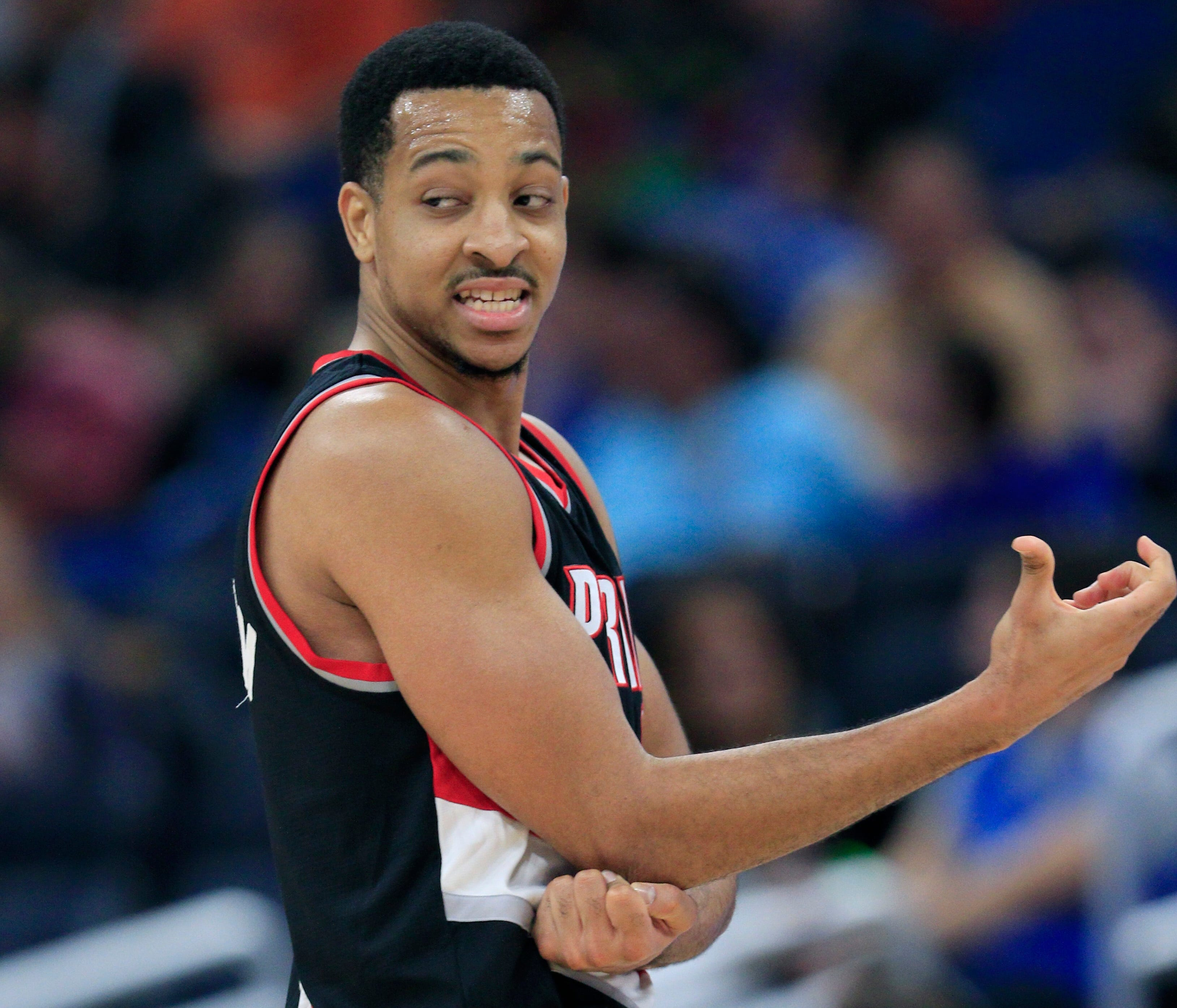 Feb 23, 2017; Orlando, FL, USA; Portland Trail Blazers guard C.J. McCollum (3) rubs his right elbow after a hard fall during the fourth quarter against the Orlando Magic at Amway Center. The Trail Blazers won 112-103. Mandatory Credit: Reinhold Matay