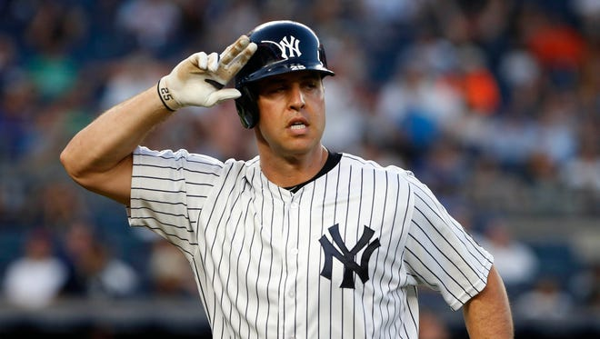 New York Yankees first baseman Mark Teixeira reacts after a hit.