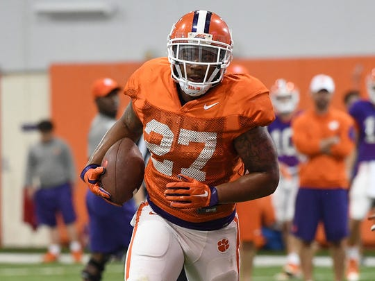 Clemson running back C.J. Fuller (27) carries the ball during the Tigers' spring practice on Monday, April 3, 2017.