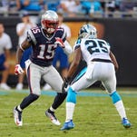 New England Patriots wide receiver Reggie Wayne starts a pass pattern covered by Carolina Panthers cornerback Bene' Benwikere (25) (15) during the first quarter at Bank of America Stadium.