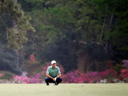 Jordan Spieth reacts to his shot off the 14th fairway during the fourth round of the Masters golf tournament Sunday, April 13, 2014, in Augusta, Ga. (AP Photo/Darron Cummings)