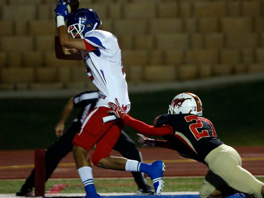 Abilene Coopers' Isaac Hatter (2) catches a touchdown pass during the football game against Coronado, Thursday, Nov. 3, 2016, at Lowry Field in Lubbock, Texas.