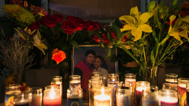 July 28, 2017 - Lit candles are placed in front of a gold framed portrait of Ismael Lopez and his wife Claudia Linares at their home during a candlelight vigil honoring Lopez in Southaven on Friday night. Lopez was shot and killed by Southaven police on Sunday night.