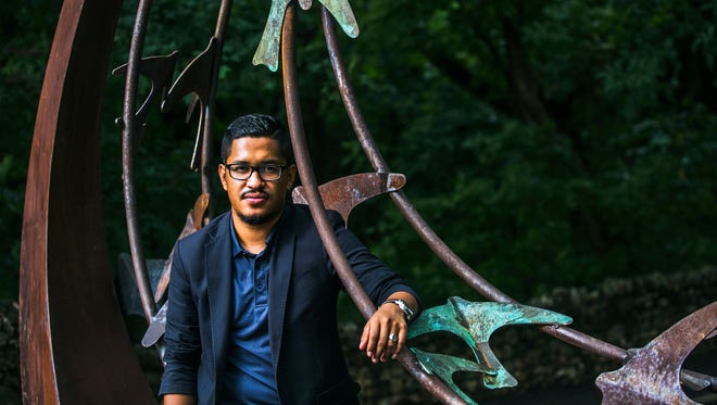"""August 17, 2017 - Alex Ortiz, 24, poses for a portrait at Overton Park on Thursday. Ortiz immigrated to the United States from Honduras with his mother in 2003 at the age of 10. """"I've fought hard for what I've been able to accomplish. Ever since i was in middle school, I've been a good student,"""" Ortiz said. """"Having DACA taken away from me would mean the end of my career. It would mean me not being able to finish grad school because I have to pay out of pocket. So, if I don't have a job, I can not pay for my tuition. It would basically destroy everything that I have worked so hard for."""""""