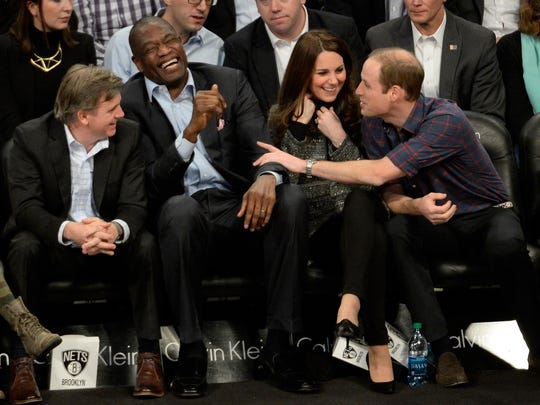 Prince William touched ex-player Dikembe Mutombo during Brooklyn Nets vs.Cleveland Cavaliers game Dec. 8 in Brooklyn.