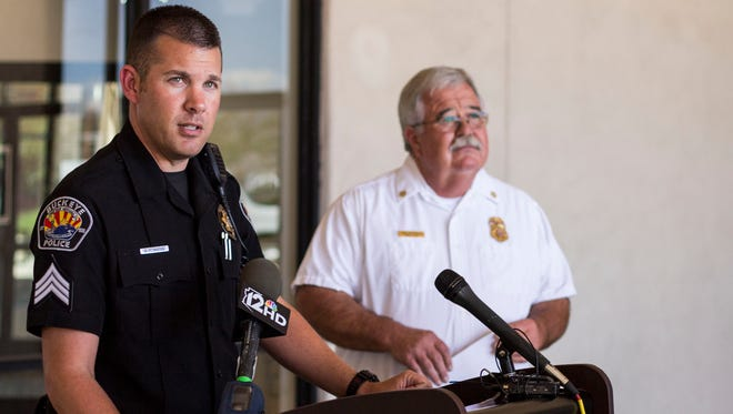 Sgt. Jason Weeks and Buckeye Fire Chief Bob Costello address the joint arson investigation which led to an arrest of a suspect on April 28.