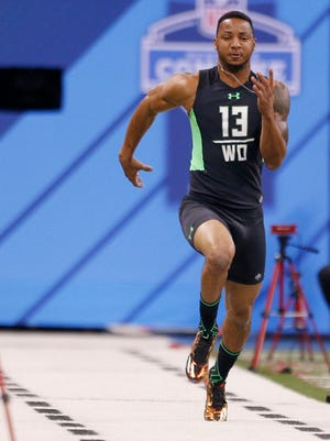 TCU wide receiver Josh Doctson runs the 40-yard dash during the 2016 NFL Scouting Combine in Indianapolis. He could be a Bengals target at pick No. 24.