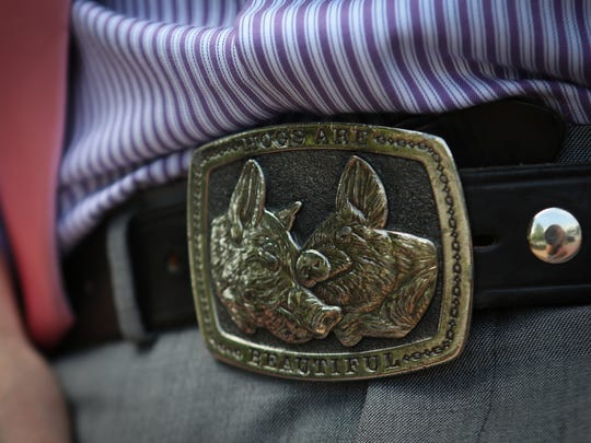 James Dawson wears a pig belt buckle from The Great American Buckle Co.