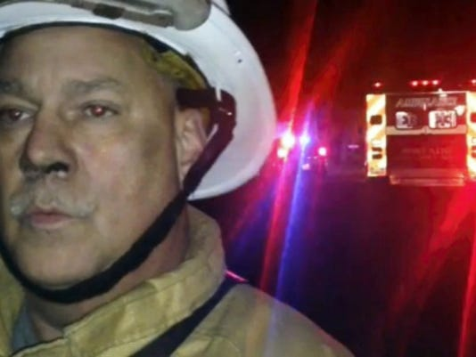 Mont Alto Fire Chief Mark Garling talks about the fire under investigation Tuesday on Shoestring Hill Dr., Quincy Township.