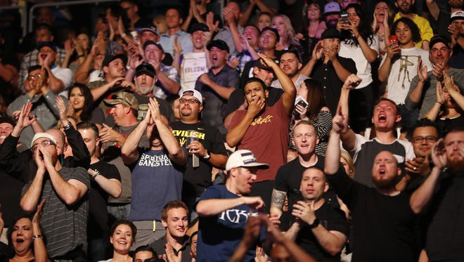Fans react to Dustin Poirier and Justin Gaethje fighting during UFC Fight Night at Gila River Arena in Glendale, Ariz. on April 14, 2018.