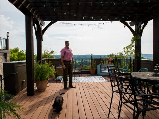 Rob Niemann stands on top of his rooftop villa with his dog, Maria. Niemann rented his home on Airbnb for the eclipse in August 2017.