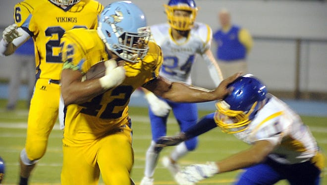 Cape Henlopen's Kolbi Wright (42) stiff arms a Sussex Central defender on Friday, Oct. 7 in Lewes.