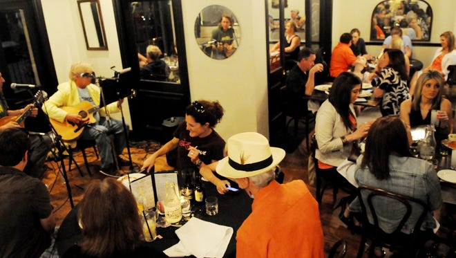 People enjoy dinner and music at Bistro Byronz on a Friday evening.