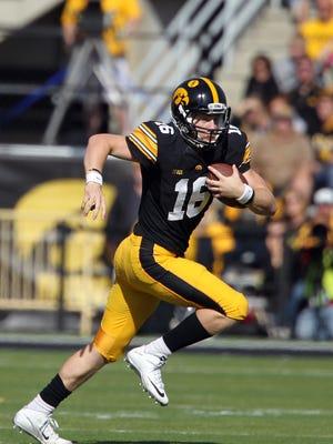 Iowa quarterback C.J. Beathard runs down field during the Hawkeyes' game against Illinois at Kinnick Stadium on Saturday, Oct. 10, 2015.