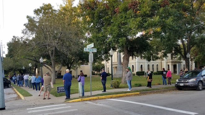Voters line up at the Bastrop County Courthouse to vote on Oct. 13, the first day of early voting for the Nov. 3 general election.