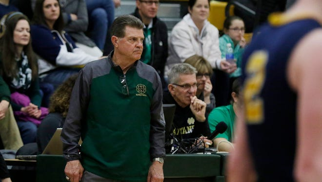Oshkosh North High School's Frank Schade keeps an eye on the Spartans as they play.  Oshkosh North Spartans hosted Wausau West Warriors in a WIAA regional finals boys basketball game March 4, 2017.  The Spartans beat the Warriors 69 - 47.Joe Sienkiewicz / USA TODAY NETWORK-Wisconsin