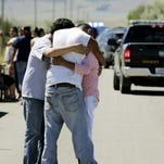 Family members embrace at the scene of a shooting in Pryor on the Crow Reservation on Wednesday. A suspect was arrested hours later in Wyoming, FBI spokesman Todd Palmer said.