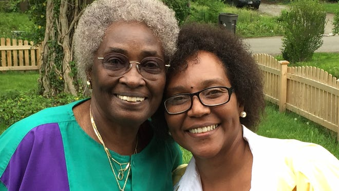 Doris Jones-Byrd (left) and Angela Darwiche-Smith met Monday after Byrd read about Smith in last week's IndyStar. Byrd gave Smith a large keyboard so she can continue learning piano when she moves into her new apartment.