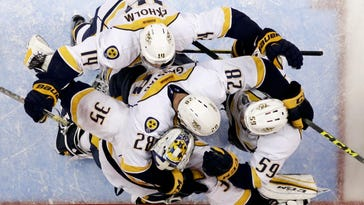 The Nashville Predators celebrate a 2-1 win over the Anaheim Ducks in Game 7 of the first round on April 27, 2016.