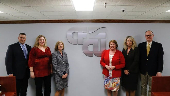 (Left to right) CFCU CFO Paul Kirk, Executive Assistant Mallorie David, Beth Putnam, chief retail officer; CEO Lisa Whitaker, Cathy Benson, chief lending officer; and William Crane, chief administration officer.
