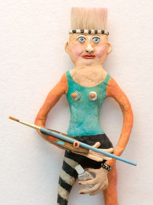 """Pat Kumicich's """"Artist with a Brush Cut"""" appears in the Naples Art Association exhibit """"Passionately Repurposed."""""""