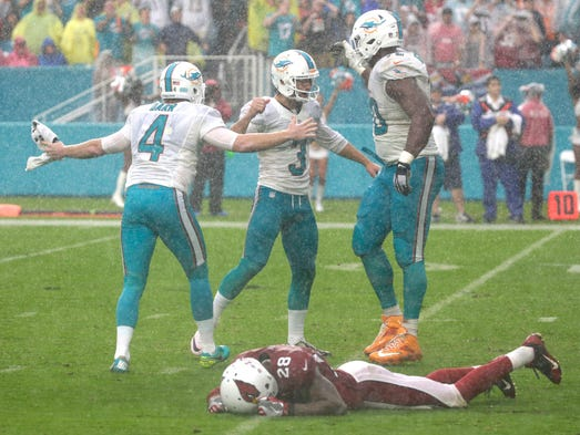 Miami Dolphins tackle Ja'Wuan James (70) and punter