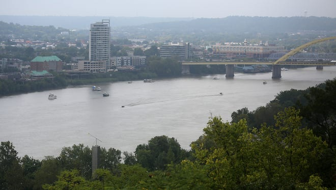 Boats remain on the Ohio River after Riverfest, as seen from the overview at Eden Park on Monday, September 1, 2014.