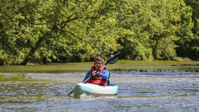 Sam Stewart, Facilities and Program Director for the Parklands of Floyds Forks, paddles the river.May 19, 2016