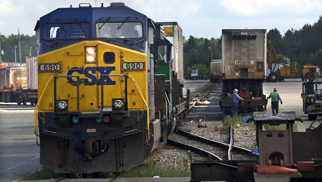 Railroad company CSX to lay off 1,000 in management