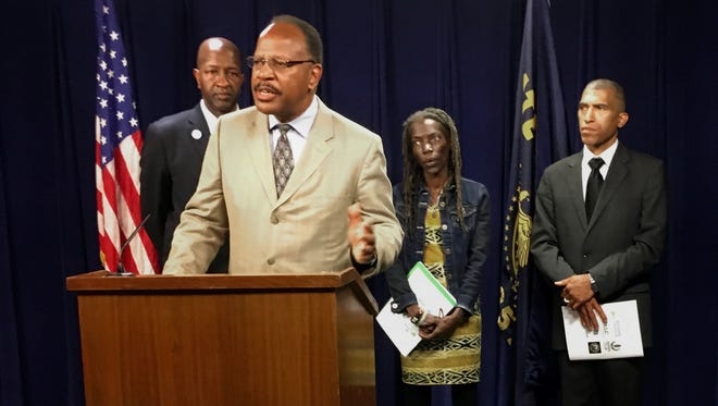 Presidents of the four branches in Oregon of the NAACP from left, Frederick Edwards, Corvallis branch; Benny Williams, at podium, from the Salem Keizer branch; Jo Anne Hardesty, Portland branch; and Eric Richardson, Eugene-Springfield branch attend a news conference Monday, June 12, 2017, at the state Capitol in Salem, Ore. The four came to State Capitol to support several bills, including one designed to end racial profiling by police, and to release a report that urges greater inclusiveness of minorities as the state turns to renewable energy.