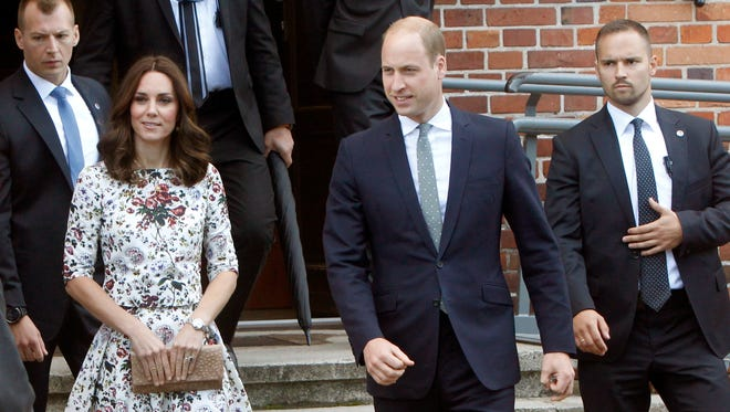 Prince William and Kate, the Duchess of Cambridge, walk through the grounds of the former Nazi concentration camp Stutthof.