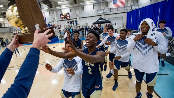 East Memorial players claim their AISA Class A Boys State Championship trophy after defeating Evangel in Montgomery, Ala., on Saturday February 3, 2018.