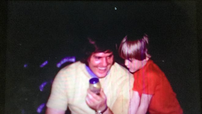 Kevin Foote with his father in  a still photo taken from an old family video.