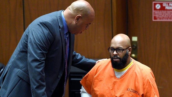 "In this March 9, 2015, photo, attorney Mathew Fletcher, left, talks with his client Marion ""Suge"" Knight upon his arrival  in court for a hearing about evidence in his murder case, in Los Angeles, Calif."